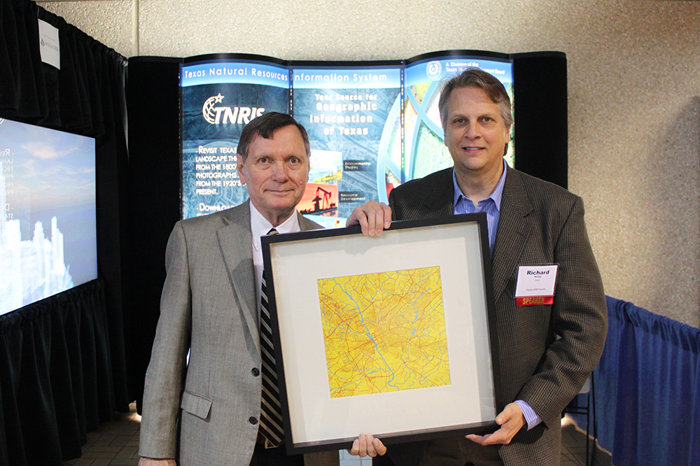 Keynote Dr. David Cowen is presented with a map of his hometown of Columbia, South Carolina.
