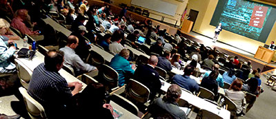 Audience and speaker at the Texas GIS Forum