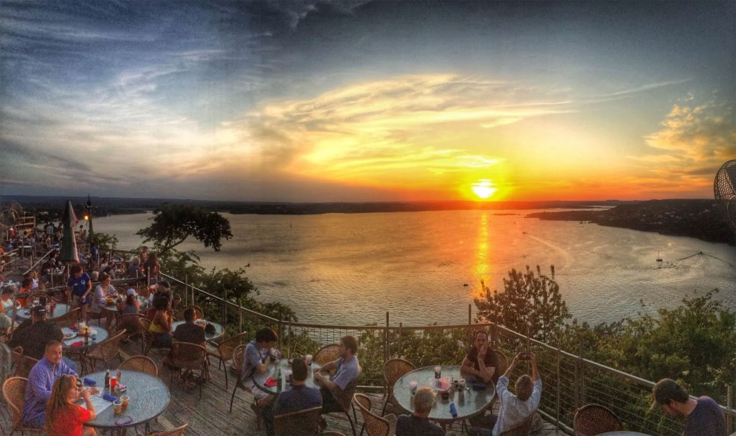 Photo of sunset on the deck of The Oasis at Lake Travis