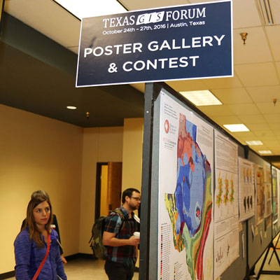 A thumbnail showing people looking at the GIS Forum Poster Gallery