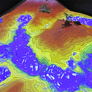 A thumbnail of the augmented reality sandbox, projected topography
